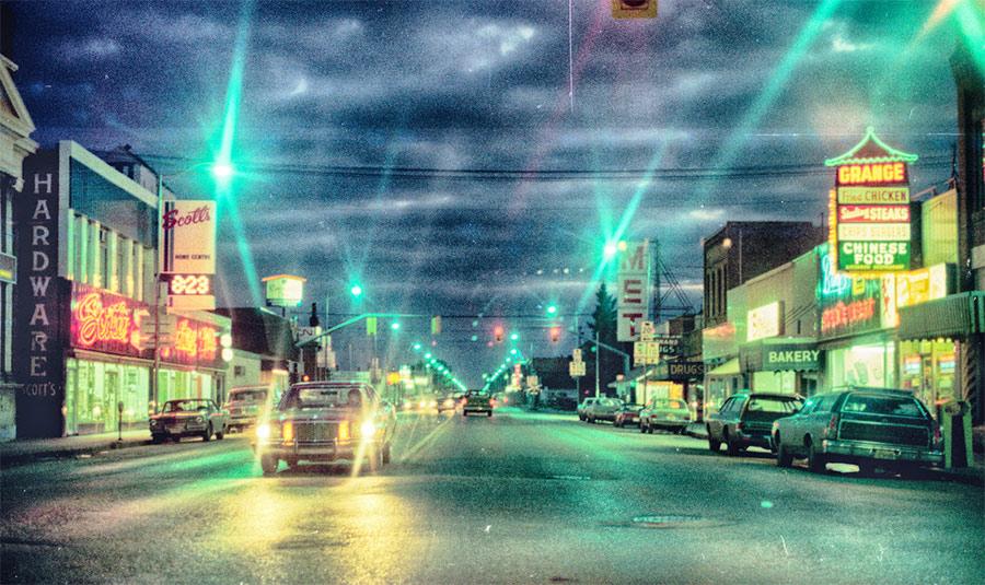 Photo  of Main Street at dusk, Dauphin Manitoba around 1974.